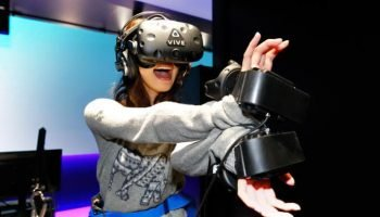 Woman playing VIVE VR Gear at VR Zone Shinjuku